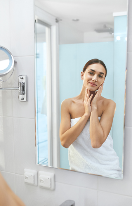 A woman practices a proper skincare routine by age.